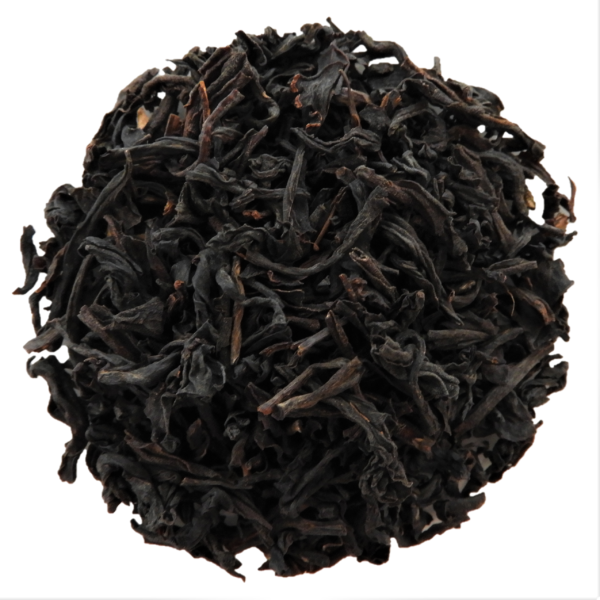 Black tea in a circle with white background.