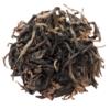 Loose leaf green tea on white background.