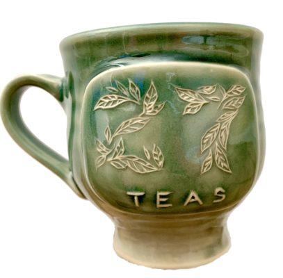 Green hand made mug with 27Teas on it.