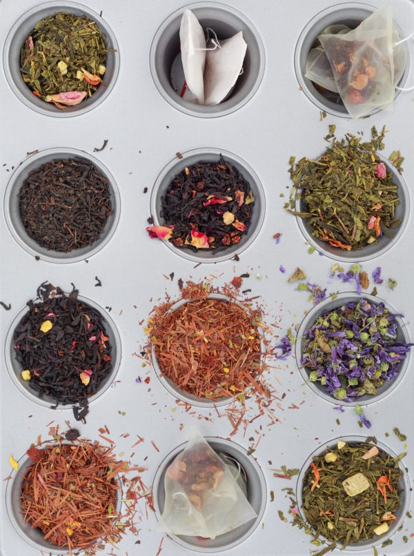 Display of 12 tea samples in muffin tin.