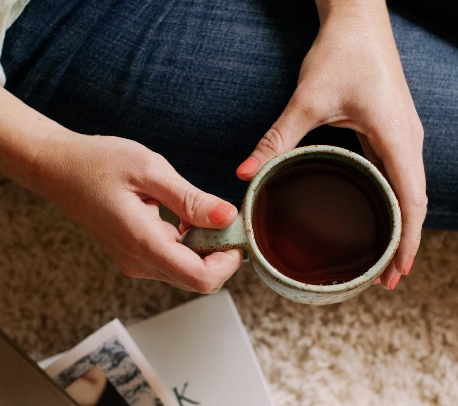 Holding cup of tea