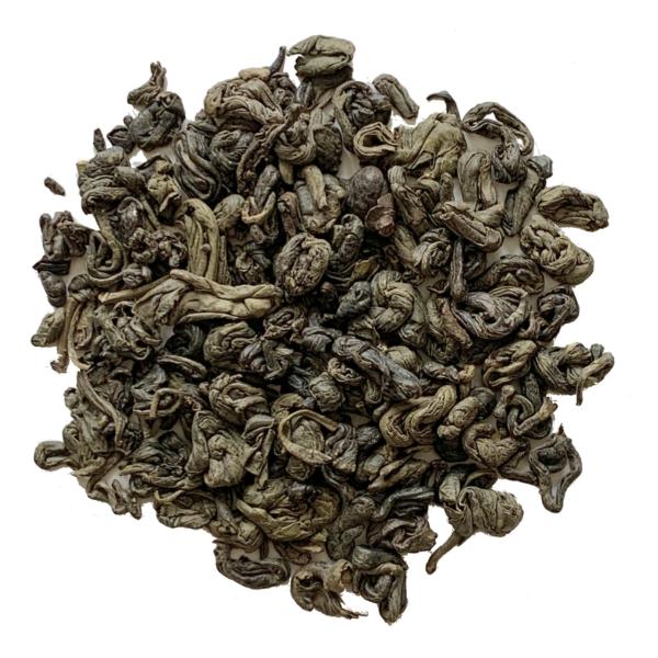 Loose leaf gunpowder green tea on white background.
