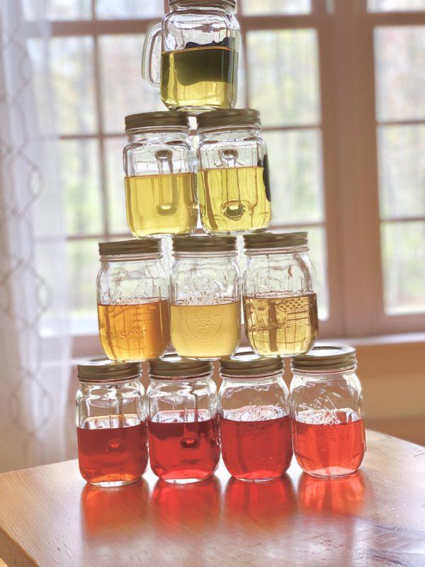 A tower of iced tea jars.