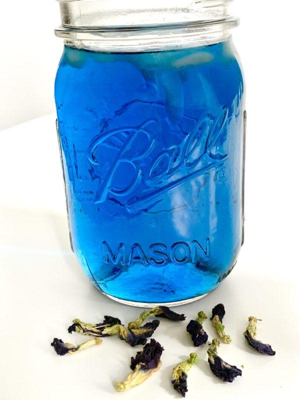 Blue Butterfly Pea Flower tea in mason jar.